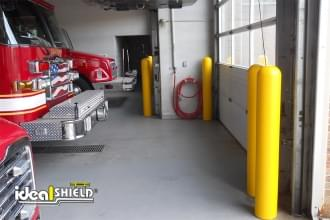 Yellow 1/8 Inch Bollard Covers Fire Station Door