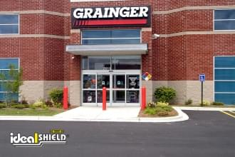 Ideal Shield's plastic Bollard Covers guarding the front of a Grainger entrance