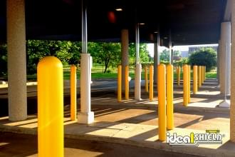 "Ideal Shield's 1/8"" Bollard Covers guarding an ATM drive-thru"