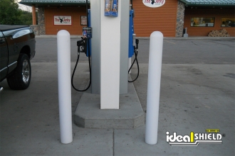 White 1/8 Inch Bollard Covers Protecting Gas Station