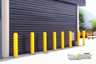 "Ideal Shield's 1/8"" bollard covers used for door protection"