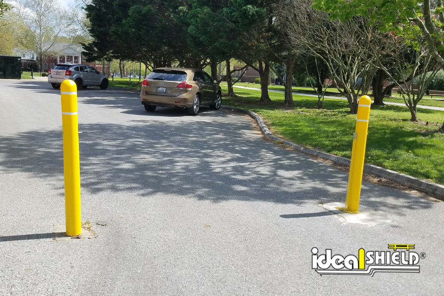 """Ideal Shield's yellow plastic 1/8"""" bollard covers with white reflective tape"""