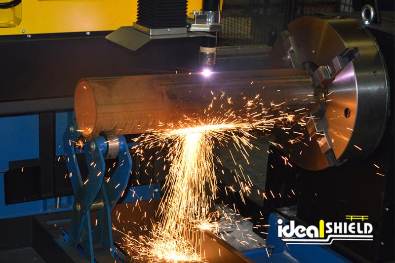 Ideal Shield's CNC Plasma Machine cutting a steel pipe bollard