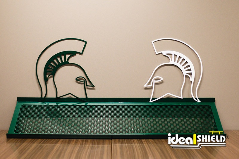 Custom cut Michigan State University Spartan helmets and shoe rack