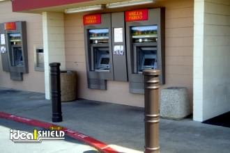 "Ideal Shield's 6"" Metro Decorative Bollard Covers used to guard an ATM at Wells Fargo"