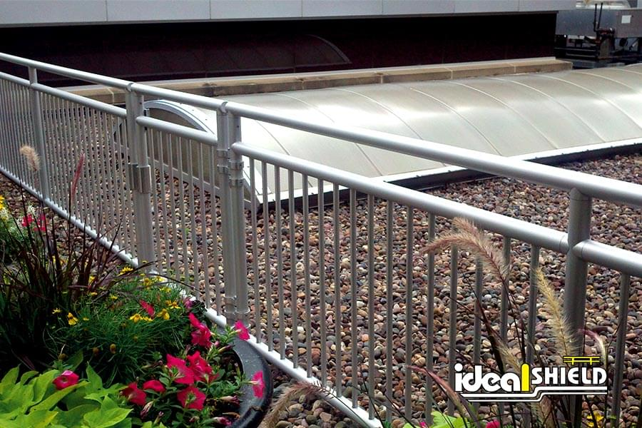 Ideal Shield's Aluminum Handrail with Gate on a Rooftop