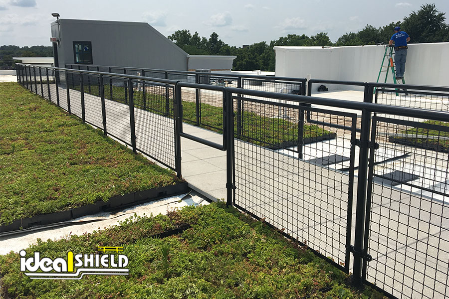 Ideal Shield's black powder-coated Aluminum Handrail with swing gate for rooftop patio