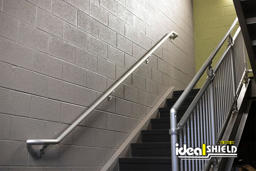 Ideal Shield's Wall Mounted Aluminum Handrail up a flight of stairs