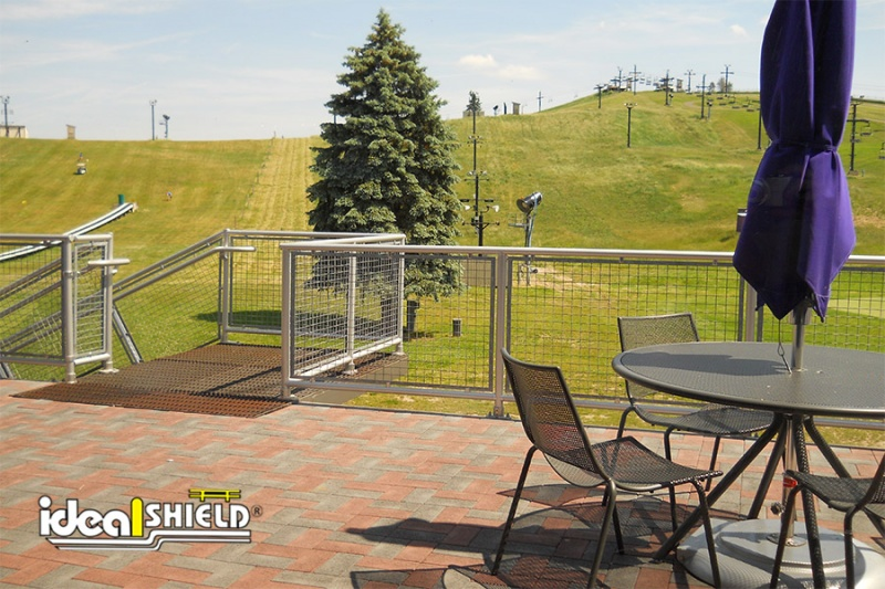 Ideal Shield's Aluminum Handrail with infill around a patio