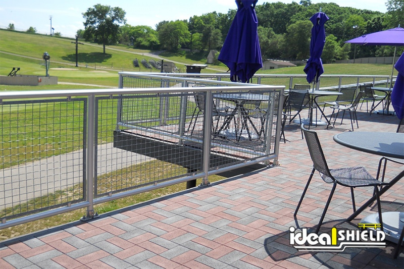 Ideal Shield's Aluminum Handrail with infill around a patio at Mount Brighton