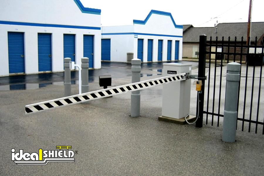 Ideal Shield's 6 Inch Architectural Bollard Covers Guarding a storage unit's lift gate
