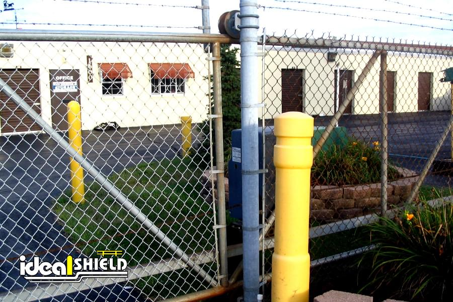 """Ideal Shield's 6"""" Architectural Decorative Bollard Covers used for gate entrance protection"""