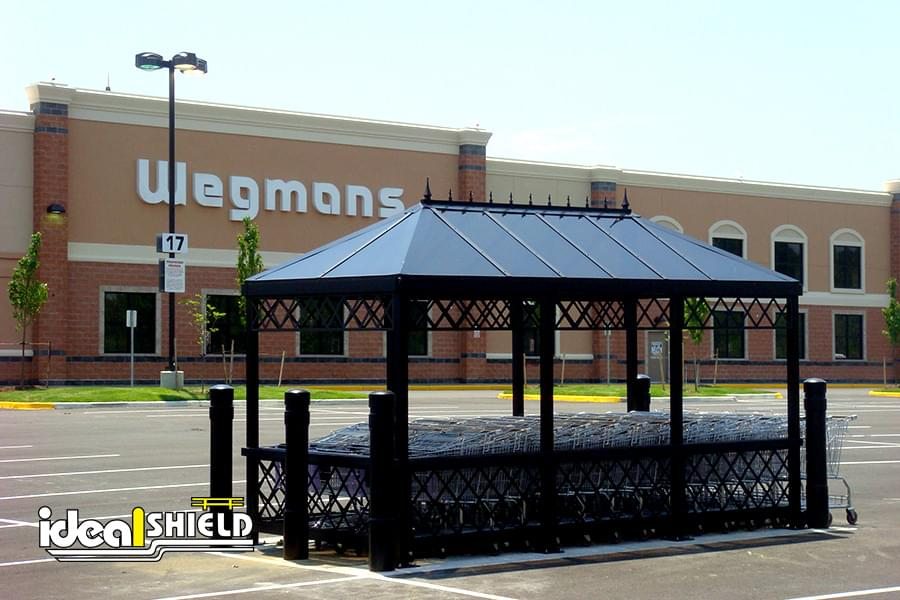 Ideal Shield's 6 Inch Architectural Decorative Bollard Covers used to protect a Cart Corral
