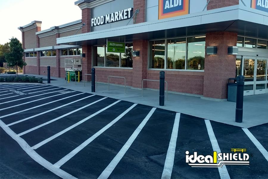 Ideal Shield's 6 inch Architectural Bollard Covers protecting an Aldi storefront