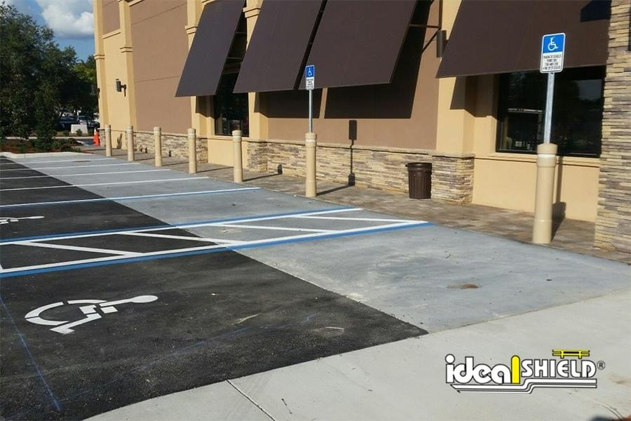 """Ideal Shield's 6"""" Architectural Bollards with Custom Color used for parking lot and storefront protection"""