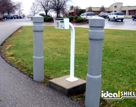 Ideal Shield's 6 inch Architectural Bollard Covers used to guard an entrance talk box
