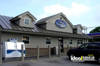 Ideal Shield's 6 Inch Architectural Decorative Bollard Covers used for storefront protection at a liquor store