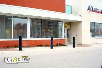 Ideal Shield's 6 Inch Architectural Decorative Bollard Covers used for storefront protection