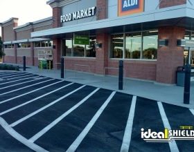 Aldi storefront protected by architectural bollard covers