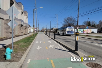 Ideal Shield's 6 inch Architectural Bollard Covers helping guard a Indianapolis area bike lane