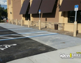 "Ideal Shield's 6"" Architectural Bollards with Custom Color used for parking lot and storefront protection"