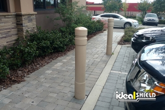 Tan 6 Inch Architectural Bollard Covers - Liquor Store Parking Lot