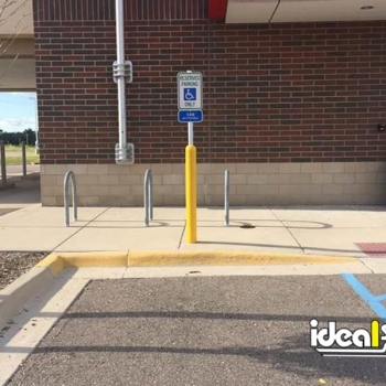 Ideal Shield's yellow Bollard Sign Systems at Bank of America's handicap accessible parking spots