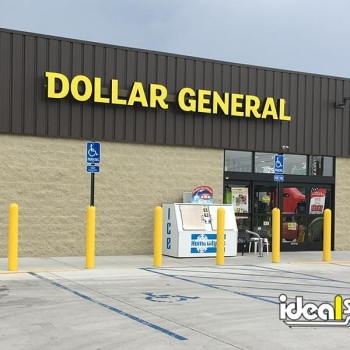 Ideal Shield's yellow bollard covers and bollard sign systems used for storefront protection at Dollar General