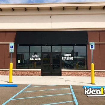 Ideal Shield's yellow Bollard Sign Systems at handicap accessible parking spots
