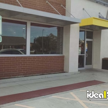 Ideal Shield's Bollard Sign Systems at McDonald's handicap accessible parking spots