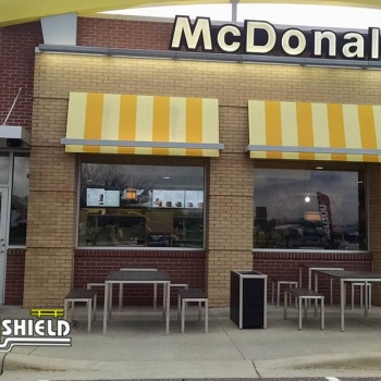 Ideal Shield's yellow plastic Bollard Sign Systems with custom logo used for handicap accessible parking spots at McDonald's