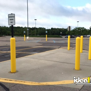 Ideal Shield's yellow Bollard Sign System for motorcycle parking only