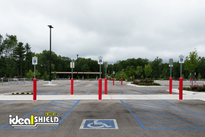 Ideal Shield's red Bollard Sign Systems used for handicap accessible parking