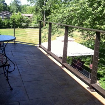 Brown Handrail With Cable Infill Along Residential Deck
