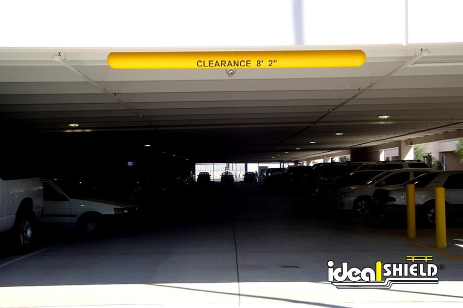 Yellow Clearance Bar On Parking Garage Ceiling