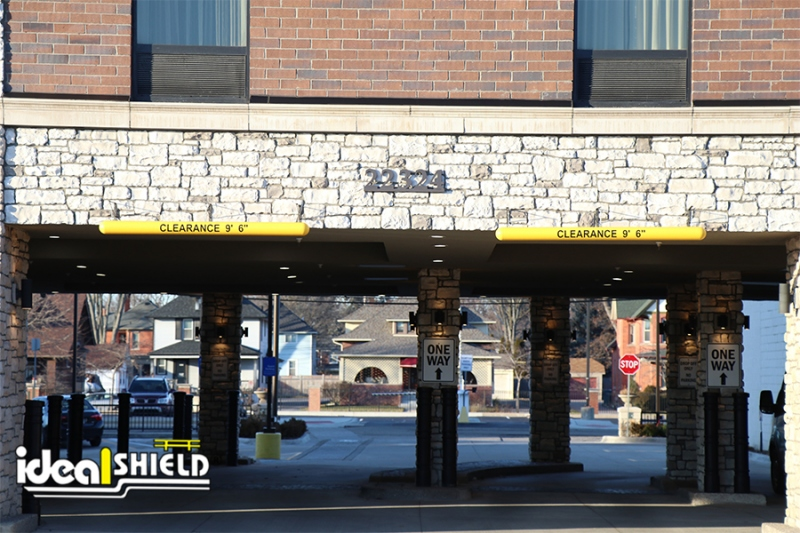 Ideal Shield's Yellow Clearance Bars hanging over a hotel entrance