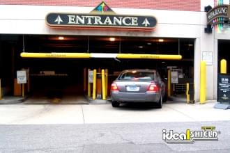 Parking Lot Entrances With Yellow Clearance Bars