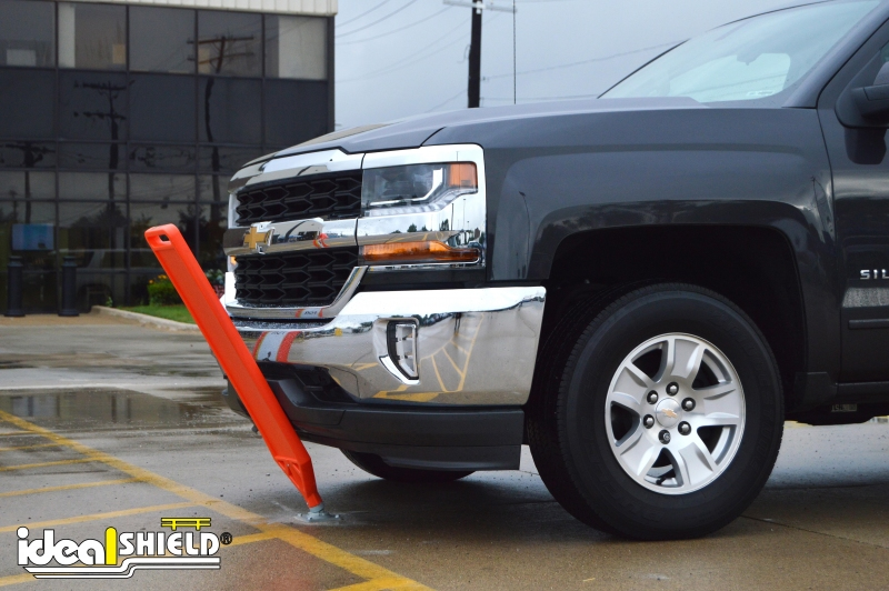 Ideal Shield's Flexible Delineator Paddle showing its ability to bend when contacted by a vehicle
