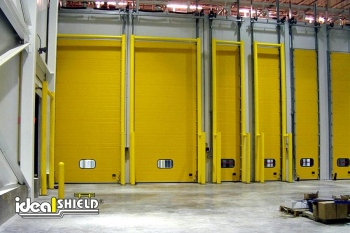 Row Of Truck Delivery Doors Protected By Goal Post Dock Door Protection System