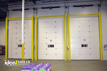 Three Garage Doors guarded  by Ideal Shield's Goal Post Dock Door Protectors
