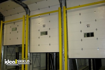 Three Garage Doors Shielded By Goal Post Dock Door Protectors