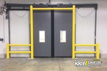 Ideal Shield's Goal Post Dock Door Protection system with custom guardrail wings for extended protection
