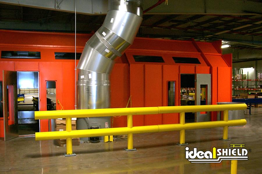 Ideal Shield's Yellow Two Line Warehouse Guardrail Installed with Base Plate Mounting