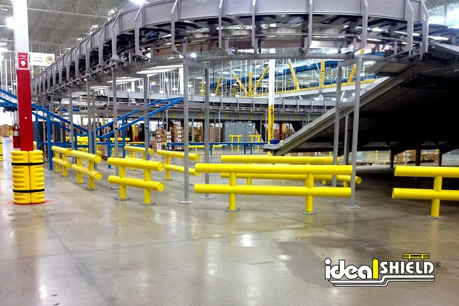 Conveyor Equipment Protected by Ideal Shield's Two Line Heavy Duty Warehouse Guardrail