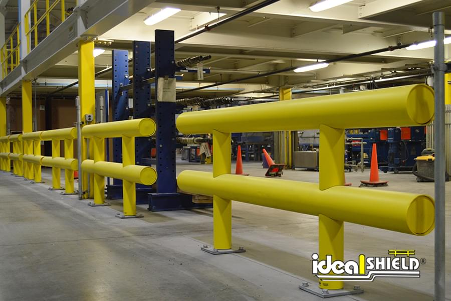 Ideal Shield's Two-Line Heavy Duty Warehouse Guardrail lining a forklift lane