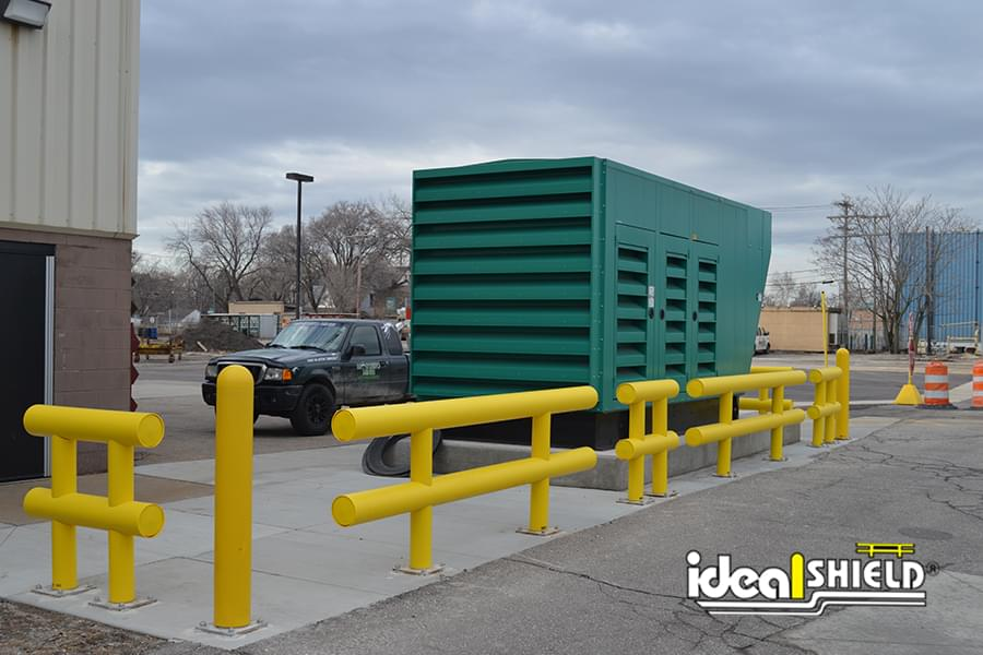 Heavy Duty Guardrail and Plated Bollards Protecting Generator