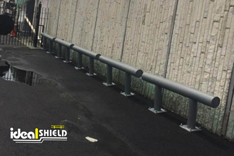 Ideal Shield's gunmetal gray One-Line Heavy-Duty Guardrail used to guard an exterior wall