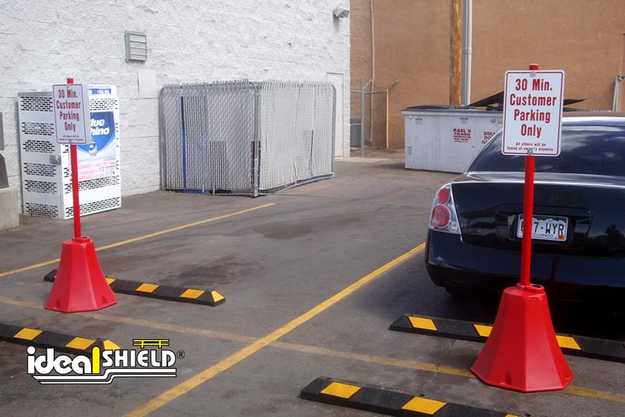 Portable Sign Bases In Red Reserving Customer Parking