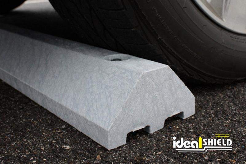 Standard Ultra Parking Block in Gray under a tire