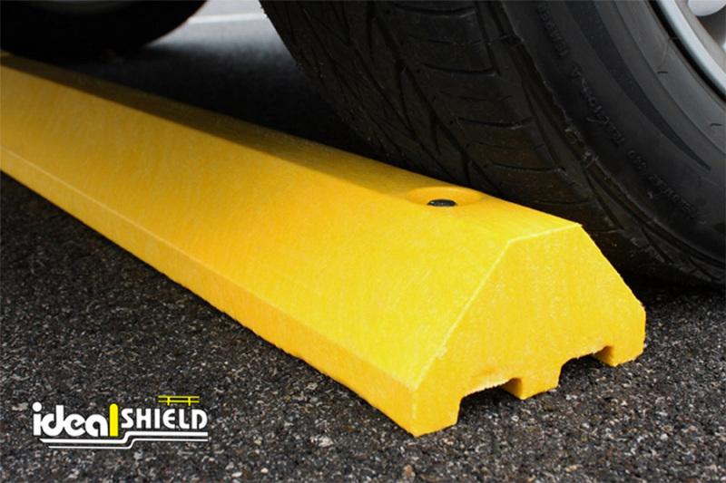 Standard Ultra Parking Block in Yellow under a tire